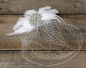 Bellamy, Feather and rhinestone birdcage with silver brooch on comb
