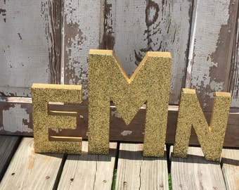 gold glitter stand up decorative monogram letters anniversary wedding reception table photo prop
