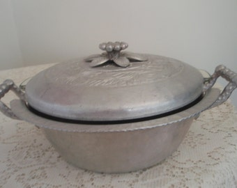 Vintage Everlast Forged Aluminum Covered Casserole Pan with vintage glass Pyrex casserole dish inside