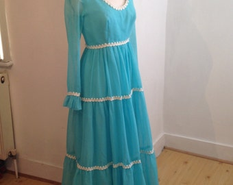 Vintage 1960s turquoise floaty maxi dress with long sleeves and knitted wool piping