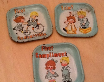 1960's dime store children's tin lithograph dishes.
