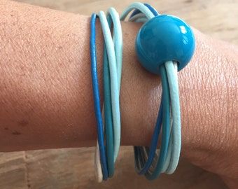 Double wrap leather bracelet, blue with pearls and a magnet clasp.