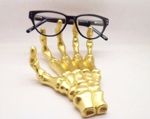Skeleton hand ring holder, holder for reading glasses, desk organizer