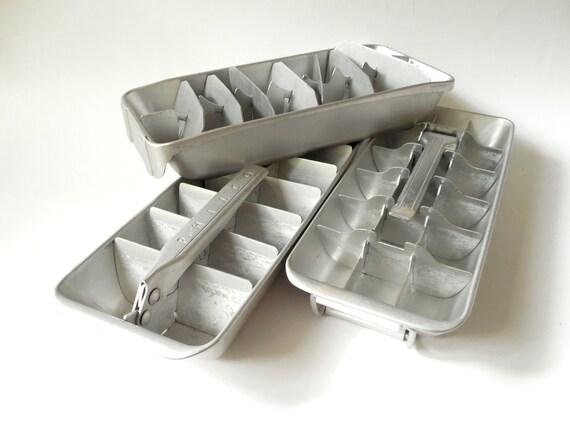 three metal ice cube trays vintage aluminum set of three. Black Bedroom Furniture Sets. Home Design Ideas