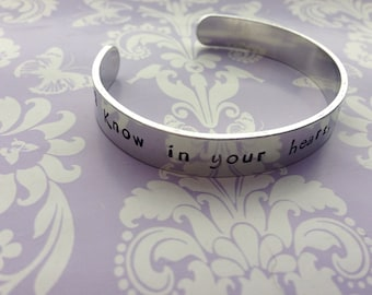 Aluminium hand stamped cuff 'know in your heart you are loved'