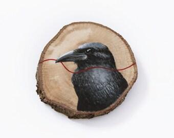 Wood slice watercolor painting raven. Wall art wood slice. Eco-friendly decor. Wood slice illustration.