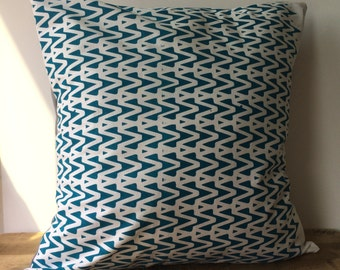 "Teal design printed on white pillow cover. Light gray fabric on back. Hand screen printed  - 18""x18"""