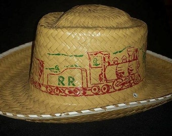 Vintage children's cowboy hat with Rail Road robbery motif