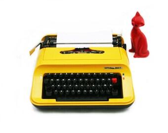 yellow typewriter with suitcase