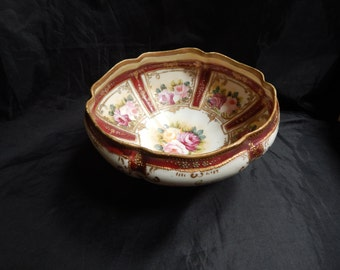Nippon Hand painted with light and dark pink and yellow roses accented with gold beads.