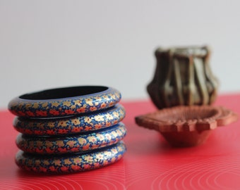 Please support Fair Trade! Hand crafted and hand painted bangle bracelet