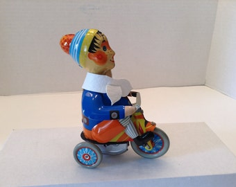 Kovap Wind Up Tin Toy ~  Boy on Tricycle with Scarf ~ Key is included~  Marked Letter A ~ Vintage Wind Up Toy Bicycle Tricycle