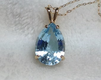 14 kt yellow gold blue topaz necklace.