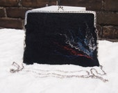 Beautiful felted purse set in black with colored silk accents.Comes with matching coin purse and card holder!  Handmade by Biddies.