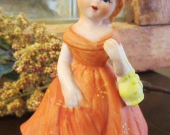 Vintage Girl With Orange Dress Figurine