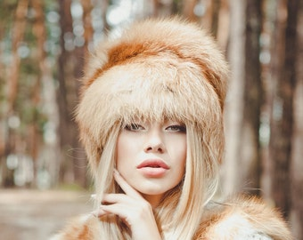 Fox fur hat with a tail