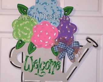 """Door Hanger - Wood Cut Out - Flowers in Watering Can. This adorable """"Flowers in Watering Can"""" can be changed to better meet your style!"""