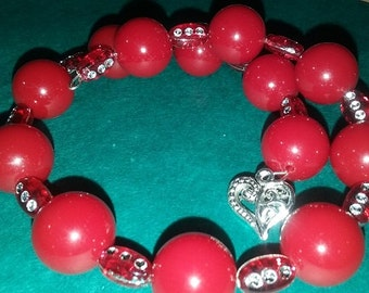 Red stacking bracelet with a silver heart and lots of sparkle!
