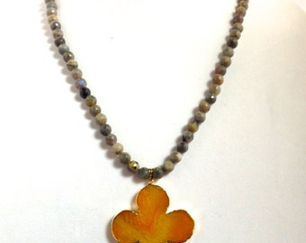 Grey beaded necklace with yellow agate pendant