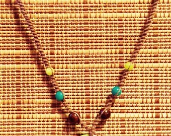 Handmade brown hemp, beaded necklace with pendant