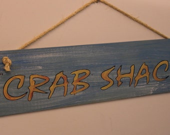 Crab Shack - Handpainted cypress wood sign with sisal rope hanger.