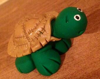 Turtle clay figurine