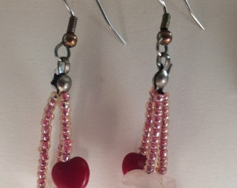 Red and white beaded dangle earrings.