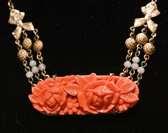 Celluloid Necklace Pendant Art Deco Carved Faux Coral Roses Relief Brass Circa 1920s Antique Jewelry Heirloom Bows Medallions Beads Beaded