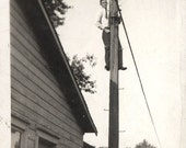 vintage photo 1920 Young Man Climbs to top of Telephone pole