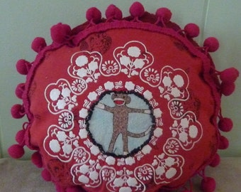 Whimsical Little Round Red Pillow- ornate pillow with happy sock monkey and pom poms!