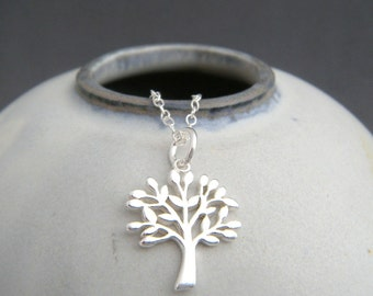 silver tree necklace. small sterling silver leaves twig branch charm. simple nature lover pendant. everyday jewelry gift for her gardener