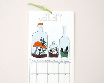 2016 Wall Calendar, 4.25x11 inches featuring 12 different garden themed illustrations in mustard, pink, orange, green, gray, red and brown