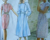 Simplicity 7754 Easy Mock Wrap Dress with slim or full skirt Size 20 to 26 UNCUT