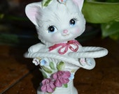 Vintage White Porcelain Cat in a Basket with Flowers