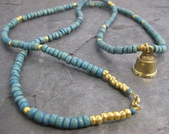 Turquoise blue coco bead necklace with brass bell and gold plated glass beads -- Boho chic