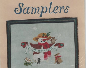 """Clearance - """"Mrs. Snow with Christmas Rose"""" Counted Cross Stitch Chart by Oberlin Samplers"""