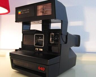 Camera Polaroid Sun 640 with red buttom Polaroid 600 serie Land Camera