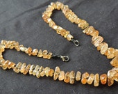 Natural tumbled Imperial Topaz beads with a knot inbetween each bead and sterling silver clasp