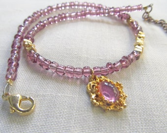 Purple beaded charm bracelet