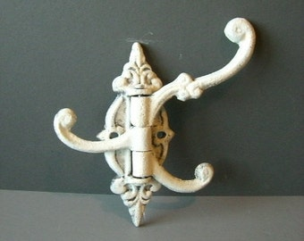 Hand painted, Cast iron wall mounted 3 arms hook. 3 swing arms hook.