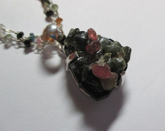 20 ct tourmaline nugget type pendant in sterling silver