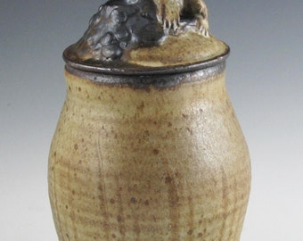 Soda fired stoneware covered jar with fossil Horned Gopher