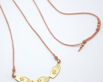 GOLDEN HANDS // Necklace of tinies bronze hands