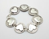 Metal Heart Bracelet With Stamped Metallic Heart Discs Linked With Silver-Tone Wire And Handwrapped Clasp