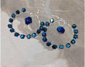 Metallic blue crystal wire wrapped hoop earrings