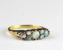Natural opal ring in 9 carat yellow gold for her