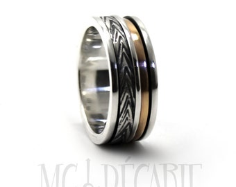 Spinner ring 9 mm; 2 mm 10k gold band and 2 silver spinners, one round and one 3mm, 2 engraving included, sterling silver and gold spinning