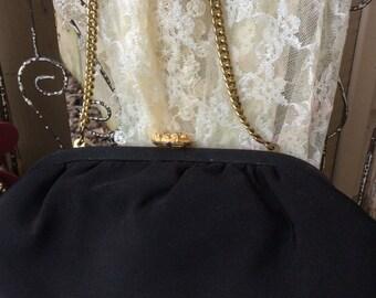 Vintage black formal handbag with jeweled enclosure