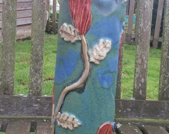 Tall stoneware sculptural decorated vase