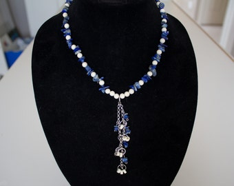 Unique and eye catching blue and white necklace.